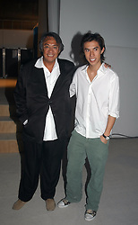 Left to right, DAVID TANG and his son EDWARD TANG at an exhibition of work by Rolf Sachs - a unique world-renowned contemporary furniture designer, held in association with the Louisa Guinness Gallery and held at 250 Brompron Road, London on 6th October 2004.<br /><br />NON EXCLUSIVE - WORLD RIGHTS