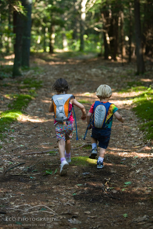 A young brother and sister go hiking in North Hampton, New Hampshire.  Near the headwaters of the Winnicut River. (MR)