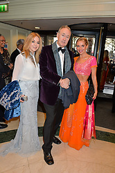 Left to right, HELEN FOSPERO, NIGEL PLANER and NIKKI BEDI at the 6th annual Asian Awards held at The Grosvenor House Hotel, Park Lane, London on 8th April 2016.