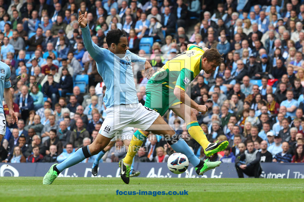 Picture by Paul Chesterton/Focus Images Ltd +44 7904 640267.Grant Holt of Norwich has a shot on goal during the Barclays Premier League match at The Etihad Stadium, Manchester.