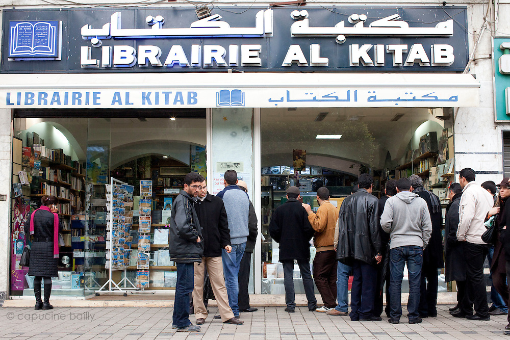 Tunis, Tunisia. January 27th 2011.On the Avenue Bourguiba, people watch the window of the Librairie Al Kitab that shows the books that were forbidden under Ben Ali's regime..A daily life scene outside the protests places, thirteen days after the ousted president Zine El Abidine Ben Ali fled the country.....