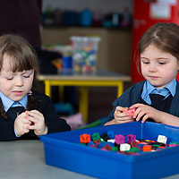 Olive Cusack and Sophie Buckley play together on their first day at Liscannor school