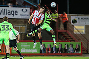 Forest Green Rovers Reece Brown(10) and Cheltenham Town's Alex Davey(29) challenge for the ball during the EFL Trophy match between Cheltenham Town and Forest Green Rovers at Whaddon Road, Cheltenham, England on 3 October 2017. Photo by Shane Healey.