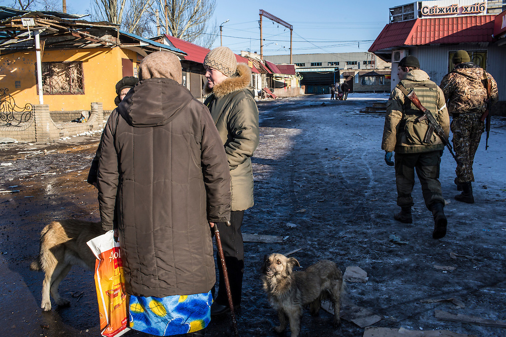 DEBALTSEVE, UKRAINE - FEBRUARY 20: Local residents and pro-Russian rebels venture out near the town center on February 20, 2015 in Debaltseve, Ukraine. Ukrainian forces withdrew from the strategic and hard-fought town after being effectively surrounded by pro-Russian rebels, though fighting has caused widespread destruction. (Photo by Brendan Hoffman/Getty Images) *** Local Caption ***