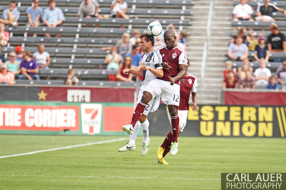 July 27th, 2013 - LA Galaxy defender Todd Dunivant (2) and Colorado Rapids midfielder Hendry Thomas (12) rise up to battle for a header in the first half of action in the Major League Soccer match between the LA Galaxy and the Colorado Rapids at Dick's Sporting Goods Park in Commerce City, CO