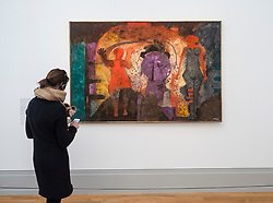 Visitor looking at painting Carnival by Rufino Tamayo, at new Museum Barberini in Potsdam Germany