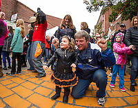 Ella Mosscrop-Finochiaro and her grampa Kevin Charron of Merrimac get into their dancing groove on PumpCanaly during Saturday's Pumpkin Fest.  (Karen Bobotas/for the Laconia Daily Sun)