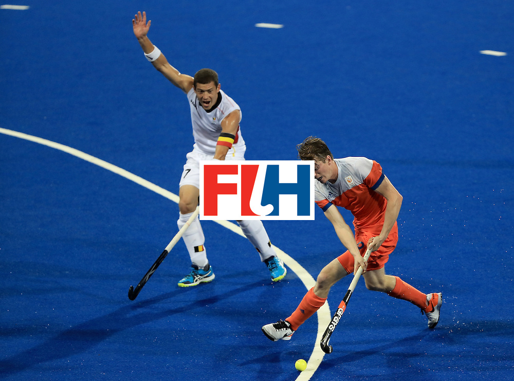 RIO DE JANEIRO, BRAZIL - AUGUST 16:  Seve van Ass #9 of the Netherlands attempts to drive past John-John Domen #7 of Belgium during a semifinal match on Day 11 of the Rio 2016 Olympic Games at the Olympic Hockey Centre on August 16, 2016 in Rio de Janeiro, Brazil.  (Photo by Sam Greenwood/Getty Images)