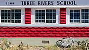 The historic red brick Three Rivers Schoolhouse, Three Rivers, New Mexico USA