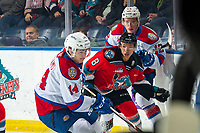 KELOWNA, BC - NOVEMBER 26: Trevor Wong #8 of the Kelowna Rockets skates into to the corner for the puck during first period while checked by Liam Keeler #12 of the Edmonton Oil Kings  at Prospera Place on November 26, 2019 in Kelowna, Canada. (Photo by Marissa Baecker/Shoot the Breeze)
