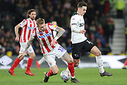 Stoke City midfielder James McClean and Derby County forward Tom Lawrence battle for the ball during the EFL Sky Bet Championship match between Derby County and Stoke City at the Pride Park, Derby, England on 12 March 2019.