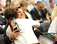 CAPTION CORRECTION: CORRECTS SPELLING TO ANDERSEN: Teacher Amy Andersen (right) is hugged and kissed by her son Jordan Andersen, 13,  (left) after she was announced as the Teacher of the Year Wednesday, October 04, 2017 at the New Jersey Department of Education in Trenton, New Jersey. (WILLIAM THOMAS CAIN / For The Philadelphia Inquirer)