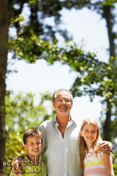 Grandfather with  Grandchildren in back yard portrait