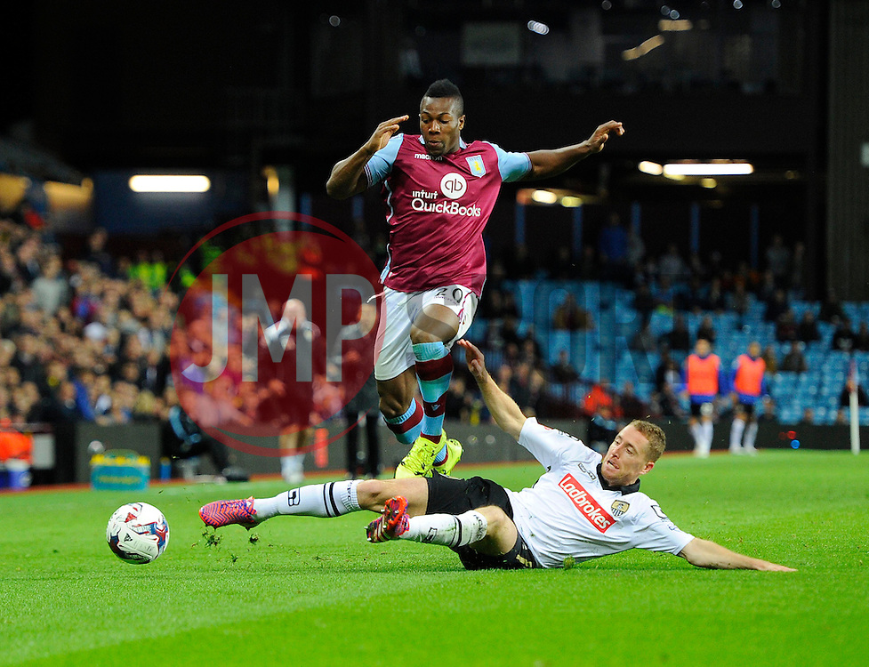 Adama Traore of Aston Villa leaps over the challenge of Gill Swerts of Notts County  - Mandatory byline: Joe Meredith/JMP - 07966386802 - 25/08/2015 - FOOTBALL - Villa Park -Birmingham,England - Aston Villa v Notts County - Capital One Cup - Second Round