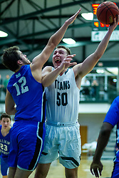 BLOOMINGTON, IL - January 04: Charlie Bair defended by Calvin Fisher during a college basketball game between the IWU Titans  and the Millikin Big Blue on January 04 2020 at Shirk Center in Bloomington, IL. (Photo by Alan Look)