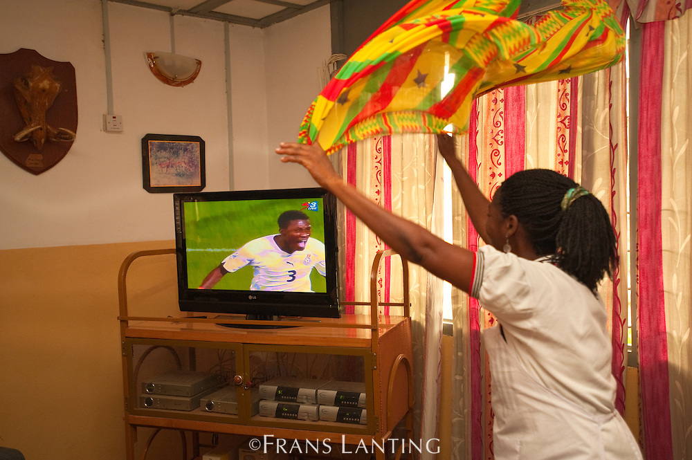 Woman cheering for Ghana during World Cup soccer match, Mole N.P. , Ghana
