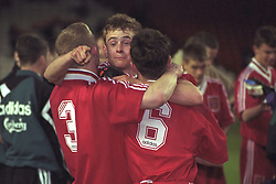 LIVERPOOL, ENGLAND - MAY 1996: Liverpool's Stuart Quinn (C) celebrates winning the FA Youth Cup with team-mates Gareth Roberts (L) and David Thompson (R) after beating West Ham United during the Final 2nd Leg at Anfield. (Pic by David Rawcliffe/Propaganda)