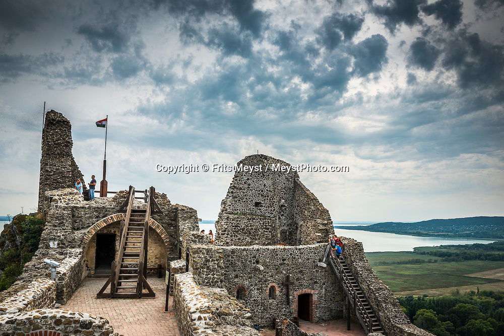 Szigliget, Balaton, Hungary, August 2015. Ruin of a fortress on top of Szigliget Castle Hill of 242 metres. the Castle was built by Favus Abbot of Pannonhalma, it was completed in 1262. A small village with a church had been developed under the Castle belonging to it as usual in the life of a border fortress. Lake Balaton is a freshwater lake in the Transdanubian region of Hungary. It is the largest lake in Central Europe and one of the region's foremost tourist destinations. The mountainous region of the northern shore is known both for its historic character and as a major wine region, while the flat southern shore is known for its resort towns. Photo by Frits Meyst / MeystPhoto.com