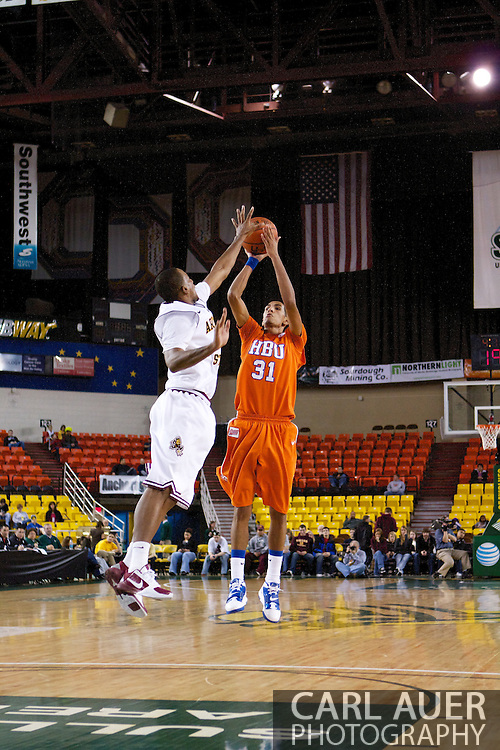 November 25th, 2010:  Anchorage, Alaska - Houston Baptist forward Andrew Gonzalez (31) attempts a three point shot in the Huskies 55-73 loss to Arizona State at the Great Alaska Shootout.  Gonzalez led all scorers with 26 points.