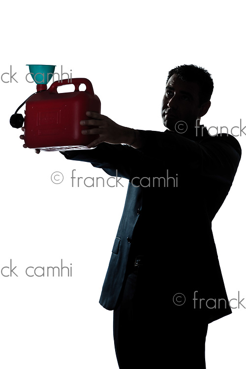 one caucasian man out of gas holding can  portrait silhouette in studio isolated white background