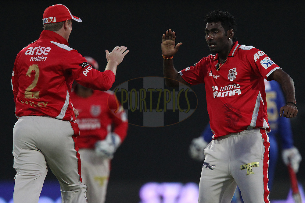 George Bailey of the Kings X1 Punjab celebrates the wicket of Ajinkya Rahane of the Rajatshan Royals with Parvinder Awana of the Kings X1 Punjab during match 7 of the Pepsi Indian Premier League 2014 between the Rajasthan Royals and The Kings XI Punjab held at the Sharjah Cricket Stadium, Sharjah, United Arab Emirates on the 20th April 2014<br /> <br /> Photo by Ron Gaunt / IPL / SPORTZPICS