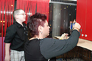 mother lights the Chanukah Menorah while her son watches