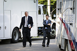 July 5, 2018 - Toronto, ON, Canada - TORONTO, ON - JULY 5  -  Toronto police homicide Det. Hank Idsinga (L) and Det. David Dickinson, walk around police vehicles near 53 Mallory Cres.prior to a news conference, July 5, 2018. Det. Idsinga told reporters that canine units identified several locations near the 53 Mallory Cres. home a few weeks ago that needed more investigation, prompting more excavation at the site Wednesday.  Andrew Francis Wallace/Toronto Star (Credit Image: © Andrew Francis Wallace/The Toronto Star via ZUMA Wire)