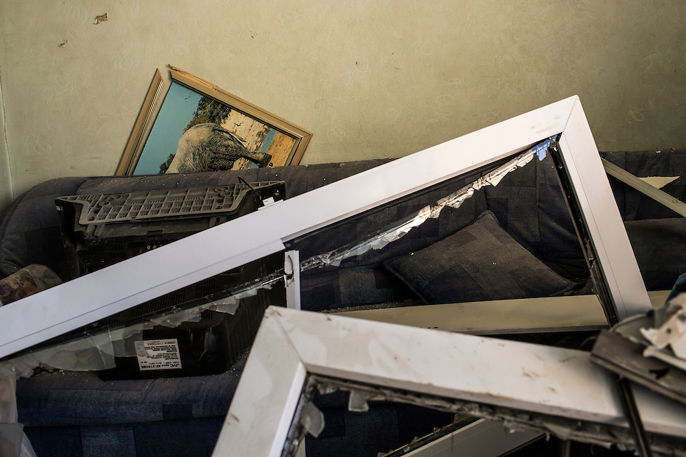An apartment which was heavily damaged after the building was hit by a suspected grad rocket strike on Tuesday, July 29, 2014 in Donetsk, Ukraine.