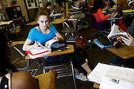 Senior Rachel Gowey, 18, of Urbandale works with her classmates on a group project Thursday, May 12, 2016, at Johnston High School in Johnston. Gowey said teachers have been flexible with her about finishing projects and papers, especially if she is on the road competing at gymnastics competitions across the country.