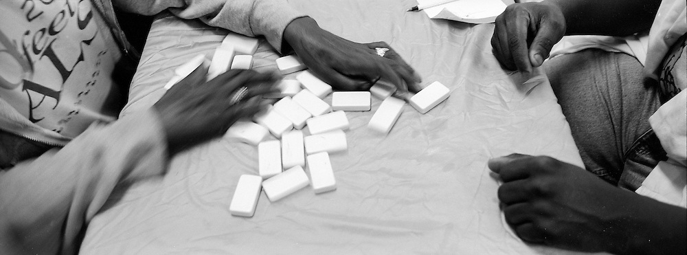 Leonard Hart, left, prepares for his next domino game. Hart is a palliative care patient in the Angola hospice program. He says, ?I can talk to each one of my volunteers about anything I'm going through. It is a comfort to have them listen.?