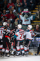 KELOWNA, CANADA - FEBRUARY 14: Rocky Racoon, the mascot of the Kelowna Rockets mocks a squirmish amongst players on February 14, 2015 at Prospera Place in Kelowna, British Columbia, Canada.  (Photo by Marissa Baecker/Shoot the Breeze)  *** Local Caption *** Rocky Racoon; mascot;