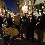 Activists wearing Anonymous masked and a sign saying; You cant evict an idea. They line up for television, BBC London, which is about to broadcast live from the square. The camp Occupy London Stock Exchange outside St Paul's Cathedral was in the morning served with eviction notice after months of legal battle with the Corporation of London. The site was occupied Oct 15th.