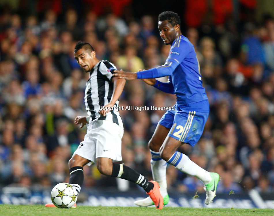 19.09.12 London, ENGLAND: <br /> Arturo Vidal of Juventus F.C. and John Obi Mikel of Chelsea<br /> during the UEFA Champions League Group E match between Chelsea and  Juventus at Stamford Bridge Stadium