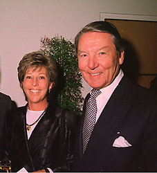 MR & MRS TOMMY SOPWITH at a party in London on 21st April 1998. <br /> MGU 68 2ORO