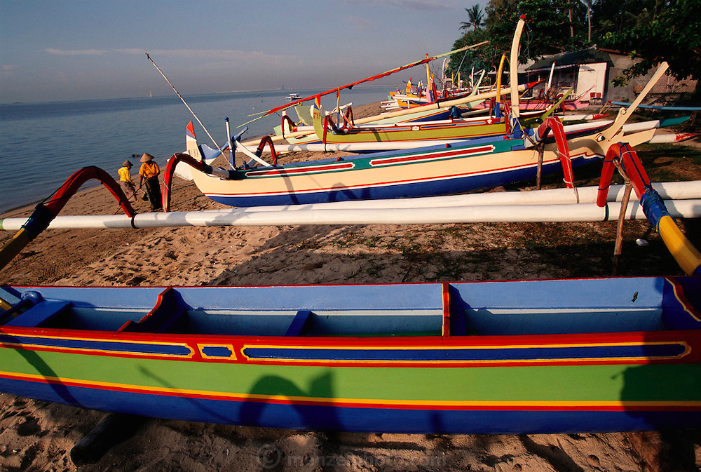 Brightly painted wooden boats on Sanur Beach, Bali, Indonesia.