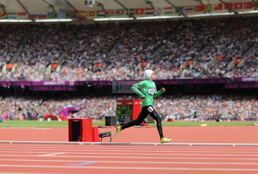 Sarah Attar of Saudi Arabia competes in an 800m heat during track and field at the Olympic Stadium during day 12 of the London Olympic Games in London, England, United Kingdom on August 8, 2012..(Jed Jacobsohn/for The New York Times)..