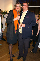 CAMILLA MAY and AXEL VAN DRONGELEN at an exhibition of art by Jeffrey Kroll entitled Imirage held at the Arndean Gallery, Cork Street, London on 19th October 2005.<br />