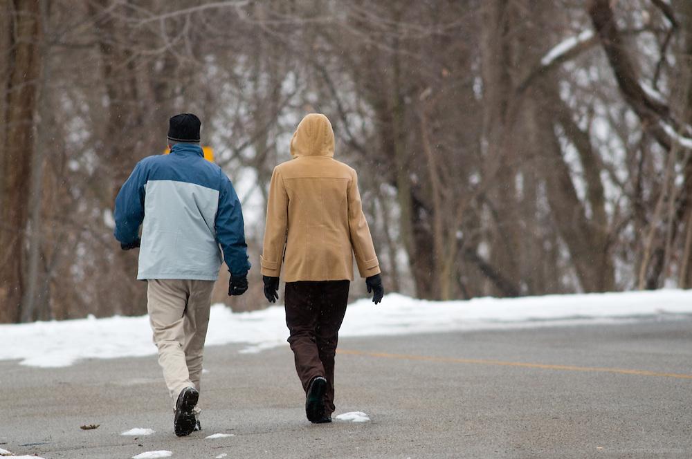 Couples walk near Hogan's Fountain in Cherokee Park, Sunday, Feb. 14, 2010 in Louisville, Ky. (Photo by Brian Bohannon)