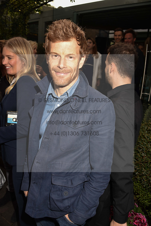 Tom Aitkens at The Ivy Chelsea Garden's Annual Summer Garden Party, The Ivy Chelsea Garden, 197 King's Road, London England. 9 May 2017.<br /> Photo by Dominic O'Neill/SilverHub 0203 174 1069 sales@silverhubmedia.com