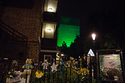 """London, UK. 14th June, 2018. The Green for Grenfell illuminations are lit at the Grenfell Tower, as well as at the twelve closest tower blocks, on the first anniversary of the fire in a display intended to 'shine a light"""" of love and solidarity for all those affected and to raise awareness of the plight of those still without new homes after one year. Green for Grenfell is a community-led initiative in collaboration with tenants' and residents' associations and Grenfell United."""