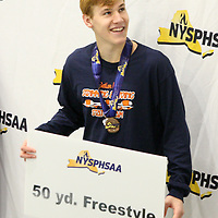 Matt Marsh on the awards podiem after placing first during the 50 freestyle during the New York State swimming championship photo by Mark L. Anderson