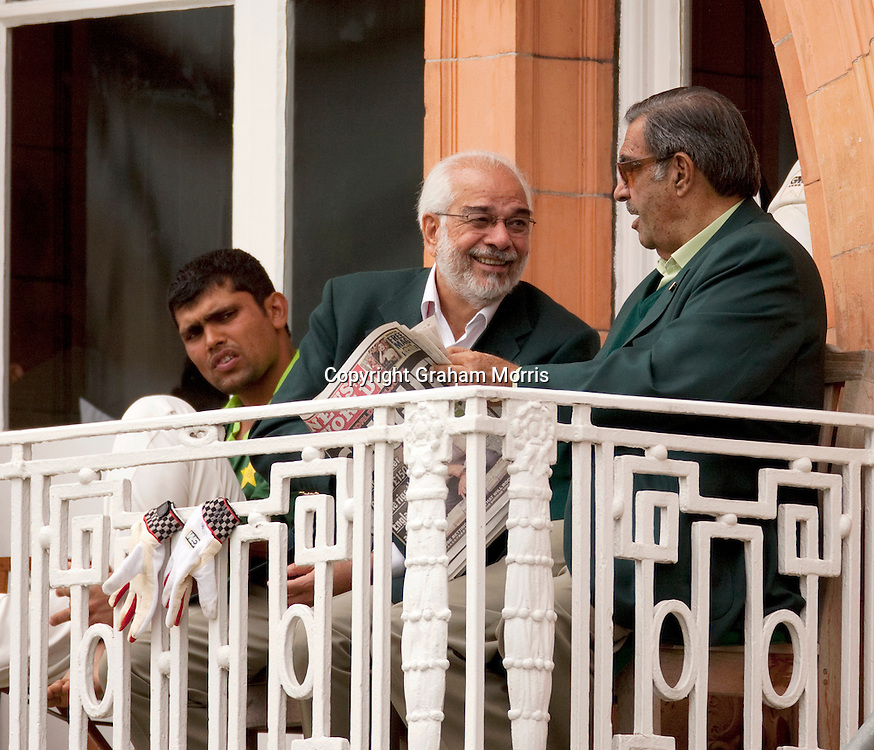 Pakistan manager Yawar Saeed (right), Assistant Manager Shafqat Rana (brother of controversial umpire Shakoor Rana) and Kamran Akmal (left) reading the News of the World on the team's dressing room balcony after it broke the match fixing scandal during the final npower Test Match against England at Lord's.  Photo: Graham Morris (Tel: +44(0)20 8969 4192 Email: sales@cricketpix.com) 29/08/10