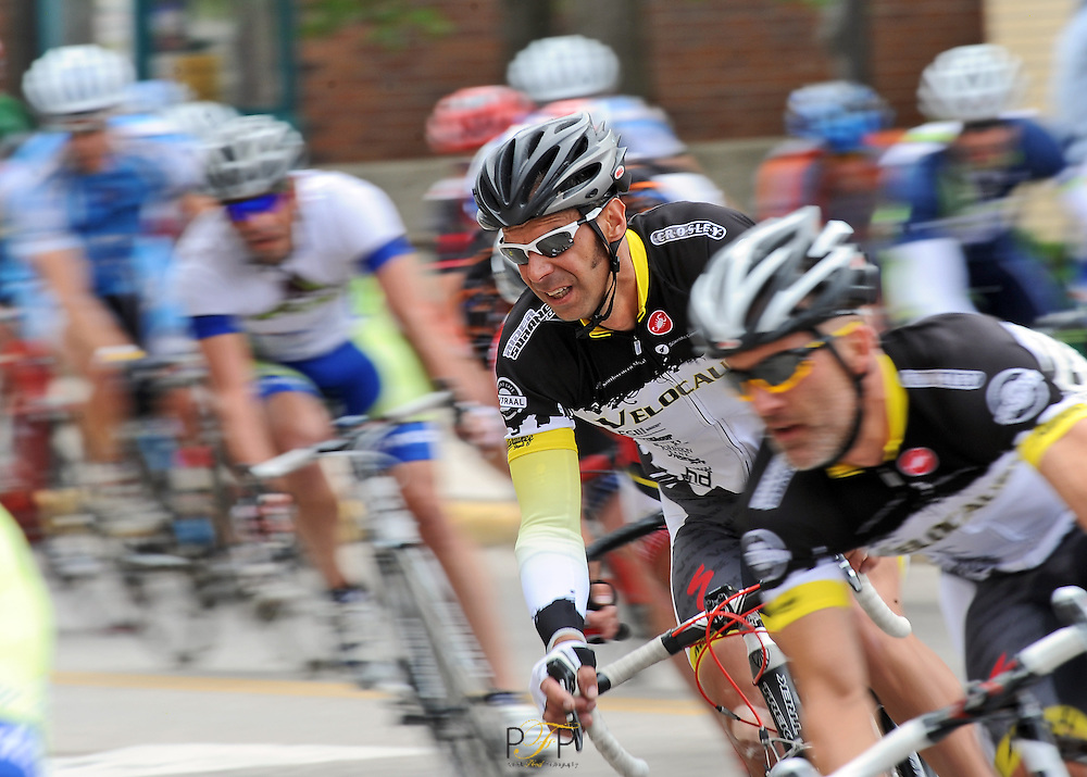 Racers bunch up before a turn during the Category 3 race at the Fond du lac Gran Prix bike races held in downtown Fond du Lac. Friday, June 24, 2011. The Reporter photo by Patrick Flood.