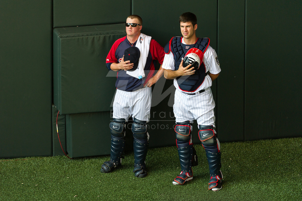 Minnesota Twins Joe Mauer #7 and Nate Dammann #75 stand during the national anthem before a game against the Baltimore Orioles at Target Field in Minneapolis, Minnesota on July 16, 2012.  The Twins defeated the Orioles 19 to 7 setting a Target Field record for runs scored by the Twins.  © 2012 Ben Krause