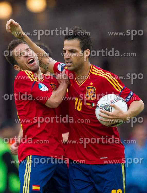 Jordi Alba of Spain and Cesc Fabregas of Spain celebrate during the UEFA EURO 2012 group C match between Spain and Italy at The Arena Gdansk on June 10, 2012 in Gdansk, Poland.  (Photo by Vid Ponikvar / Sportida.com)
