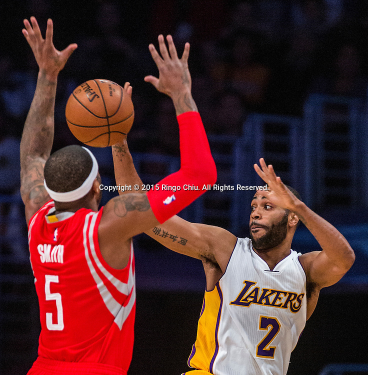 Los Angeles Lakers guard Wayne Ellington (2) passes the ball away from Houston Rockets forward Josh Smith (5) during their NBA game at Staples Center in Los Angeles, California on January 25, 2015 . Rockets defeated Lakers 99-87. (Photo by Ringo Chiu/PHOTOFORMULA.com)