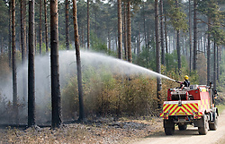 © licensed to London News Pictures. 05/05/2011. Crowthorne, UK. Firefighters continue to tackle fires in woodland  in Swinley Forest Near Crowthorne, Berkshire today (05/05/2011). Flames have been sweeping through an area of about 300  hectares, since Monday. Please see special instructions for usage rates. Photo credit should read Ben Cawthra/LNP