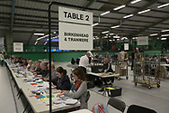 Tellers carrying out the counting of ballot papers at the count at Bidston Tennis Centre, Wirral for theBirkenhead constituency in the 2015 UK General Election. Frank Field first won the seat for Labour at the 1979 General Election and was re-elected in 2015. Voters across the UK went to the polls to vote to elect 650 constituency MPs.