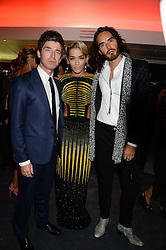 Left to right, NOEL GALLAGHER, RITA ORA and RUSSELL BRAND at the GQ Men of The Year Awards 2013 in association with Hugo Boss held at the Royal Opera House, London on 3rd September 2013.