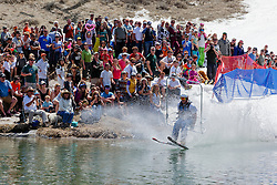 """""""Cushing Classic at Squaw Valley 11"""" - Photograph of a skier crossing a pond during the Cushing Classic at Squaw Valley, USA."""